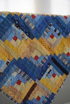 Log Cabin quilt - love the red centers