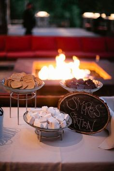 An outdoor wedding lounge complete with a s'mores bar for your guests to enjoy.