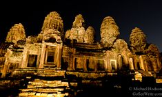 An unusual night shot of the Bayon Temple at the Angkor Wat complex. I was lucky enough to stumble across them setting up for a concert that weekend and they were testing their lights out.