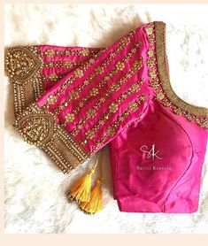 Stunning pink color designer blouse with floral design hand embroidery gold trhe… Atemberaubende Designerbluse in rosa Farbe mit goldfarbenem Trhead und Zardosi-Stickerei. Wedding Saree Blouse Designs, Pattu Saree Blouse Designs, Fancy Blouse Designs, Blouse Neck Designs, Sleeve Designs, Pink Saree Blouse, Maggam Work Designs, Stylish Blouse Design, Designer Blouse Patterns