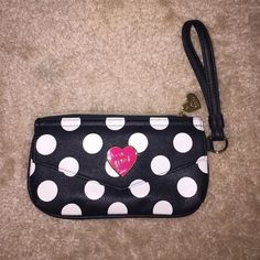 Betsey Johnson Clutch NWOT Betsey Johnson Clutch. Front black and white polka dot leather design. With a gold over flap pocket. Top zip closure to another compartment. Back design is pink and black polka dot leather design. Absolutely no damage, stains, rips, tears or scratches. Bought and never used. Betsey Johnson Bags Clutches & Wristlets