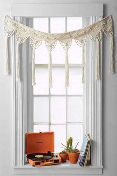 Urban Outfitters has a great little Macrame Fringe Valance! Perfect for your hippie den