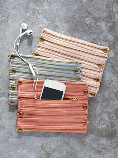 These chic pouches are easy to make! All you need is a handful of zippers, some fabric, and basic sewing skills to form one seriously cool case.