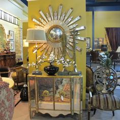 Lots of mirror going on here. Chest (and I think sunburst mirror) by John Richards.