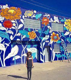 Ouizi with her work in Detroit, MI, 9/15 (LP)