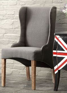 Perfect for a living room, an entryway, or dining room, the Marina Arm Chair marries the traditional wingback shape with comfortable linen upholstery, for an easygoing look that fits with most any style of decor.