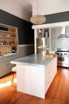 via apartment therapy. Impressive kitchen remodel (after a total gut job!)