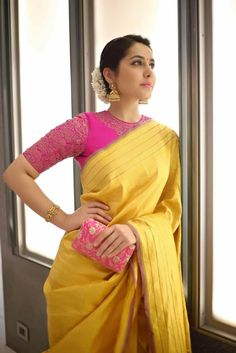 Looking for best contrast blouse ideas to try with yellow saree? Here are 13 pretty colors that can add whole lot of charm to your vibrant yellow sarees! Pink Saree Blouse, Pattu Saree Blouse Designs, Saree Blouse Patterns, Fancy Blouse Designs, Latest Saree Blouse Designs, Wedding Saree Blouse Designs, Blouse Back Neck Designs, Sari Bluse, Yellow