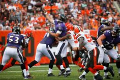 Baltimore Ravens quarterback Joe Flacco (5) throws under pressure from Cleveland Browns inside linebacker Christian Kirksey, center right, in the first half of an NFL football game, Sunday, Sept. 18, 2016, in Cleveland.