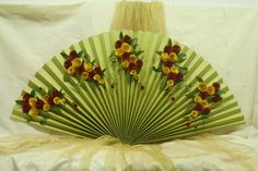 Fanfold Decoration with Paper Flowers - Made with 2 sheets of full imperial green card paper, A4 size red and yellow card papers, Fevicol MR, quilling tool/pen, golden ribbon, green Duplex paper, Fine Art Painting Brushes