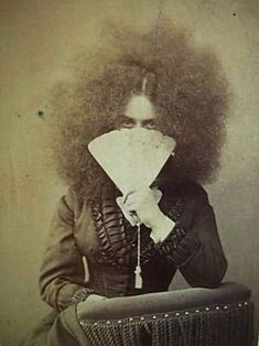 when victorian ladies run out of conditioner.....jk she is probably a circassian girl known as moss haired girls, common in sideshows.
