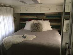 Wood behind bed and behind toilet
