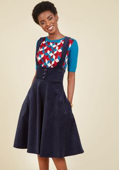 Math Club Moxie Jumper in Navy | Mod Retro Vintage Skirts | ModCloth.com  Get off to a smart start for today's competition by bolstering your confidence with this navy blue jumper. Complete with an advanced algorithm of sturdy corduroy, shining buttons, and crisscrossing straps, this retro circle skirt is the first step in the sequence that leads to your win!