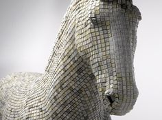 Hedonism(y) Trojaner by Babis Pangiotidis  Built entirely out of resin and recycled computer keys that range in colours from pearl white to nicotine stained yellow, this real life trojan virus displays the vulnerability we have when so dependent on the internet as part of our daily lives.