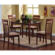 This lovely dining table and chair set will be the perfect addition to your casual, contemporary home. The simply styled table has a smooth rectangular table top above sleek square tapered legs. The table has a smaller scale, perfect for smaller homes.