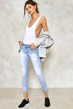 Don't ever hide your feelings. The Graffiti Heart Jeans come in light wash denim and feature a 5-pocket design, zip fly closure, skinny, low-rise, cropped silhouette, graffiti and paint splattered effect, distressed detailing, and fading throughout.