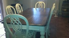 Stained top painted table  chairs.  Might try this when redoing our dining table.