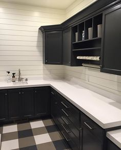 The other side of a laundry room! With the creative use of just 3 colors of solid ceramic tile they created a cool buffalo check pattern!! #uvparade #house25 by RC Dent Construction