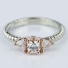 Would your wear this Two-Tone Twisted Rope Trillion Diamond Engagement Ring in White & Rose Gold?