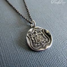 Wolf Crest Wax Seal Necklace in Latin Dum Spiro by PlumAndPoseyInc, $59.00