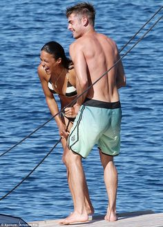 Thanks very much: She couldn't stop laughing after being pulled up onto the yacht