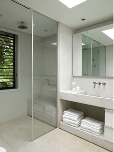 Bench in shower, visual continuation of vanity