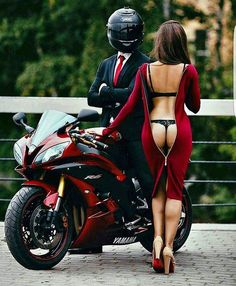 "Normally I wouldn't post a ""hot chick"" photo (mostly cause I'm a girl and I'm straight) but this is actually kinda classy. The bike is hot, guy has edgy mystery thing going on, and girl isn't doing the standard topless g-string bike straddle crap"