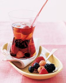 ROSE SANGRIA:  2 cups blueberries  2 cups blackberries  2 cups hulled strawberries  2 cups mixed red and golden raspberries  1 tablespoon superfine sugar  5 ounces Framboise, or other raspberry liqueur  1 bottle chilled rose wine  1 1/3 cups white cranberry juice