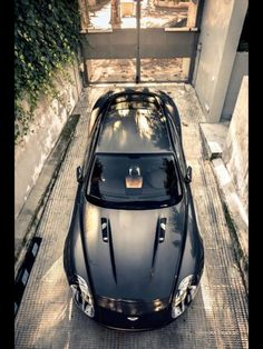 An Aston looking at home in its garage