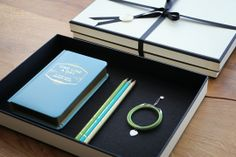 gift package with a voucher for the elaboration of a personal monogram, a…