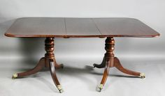 Regency Mahogany Two Pedestal Dining Table | From a unique collection of antique and modern dining room tables at https://www.1stdibs.com/furniture/tables/dining-room-tables/