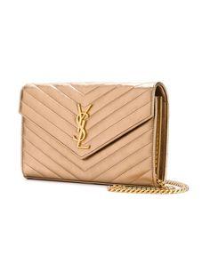bff95d2e0394c Saint Laurent Monogram Woc Gold Leather Clutch 9% off retail. Tradesy