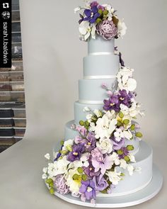 """""""Loving our Gray fondant and #sugarflowers in shades of purple and plum created for Jessica's and Robert's wedding at @plazaparties Repost…"""""""