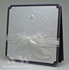 Beautiful wedding card with elegant embossed scroll on top of layers of the wedding colors.  Add pearls and a white ribbon and use a unique punch on the corners for a truly unique handmade wedding card.