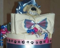 Bow-tie Bowwow 2 Tier Welcome Cake by Purrfectly Rebarkable #Pets his is a 2-tier puppy training pad welcome cake styled with a formal flair. This cake is purrfectly suitable for the new puppy whether it's a girl or a boy--or both! With the pink & blue combination frosting and neutral colored toys and treats, this new puppy gift fits a variety of party themes.