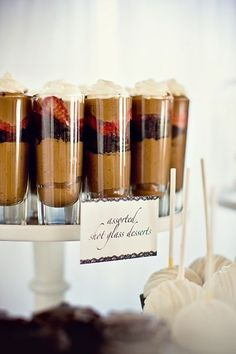 Chocolate Mousse in Shot Glasses! This could keep the guests happy while waiting in line for cake. I'm sure there are endless recipes, likely able to be made in bulk too. Make it your own! Beautiful, easy, customizable, kid friendly! (I'm thinking mason jars w homegrown mint for my laidback country #wedding!) °§£¤°