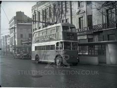 Archive black and white photograph of a double decker bus in the Old Steine, Brighton, East Sussex