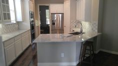 Photo of Jay the Builder - Dallas, TX, United States. Kitchen remodel with marble countertops and large peninsula