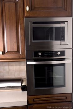 Idea Of The Day Clic Dark Walnut Colored Kitchen With Cly Built In Oven Microwave