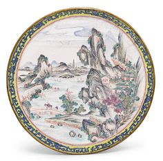 CANTON ENAMEL 'LANDSCAPE' DISH QING DYNASTY, 18TH CENTURY intricately painted with distant figures and cottages sheltered amongst a mountainous landscape with greenery along a lake with a bridge and sail boats, encircled by puce borders, the rim with a band of blue archaistic kui dragons reserved on a yellow ground, the base with a puce two-character seal mark reading shangxin surrounded by blue kui dragons on a white background, encircled by a band of eight pink bats amidst multi-coloured…