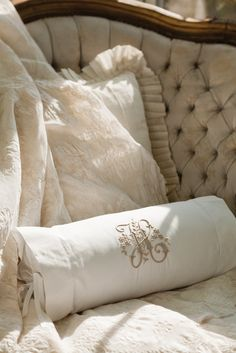 Passionate Linens Pursuit : Intricate embroidery rendered in taupe on a crisp white bolster pillow plays off the earthen tones and carvedwood accents of this tufted-velvet settee. Monogram Pillows, Diy Pillows, Decorative Pillows, Throw Pillows, Victoria Magazine, Bolster Pillow, Cozy Corner, Linens And Lace, Vintage Embroidery