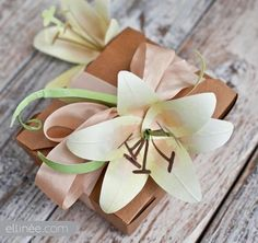 I Love this beautiful paper lily from ellinee.com , she has so many wonderful DIY'S !   DIY Paper Lily Gift Decor
