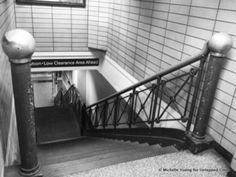 NYC - The only physical remnant of the old Penn Station is a single staircase up from one of the platforms which still has the original wrought ironwork and polished brass balustrade
