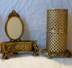Filigree Cupid Gold Brass Tone Footed Lipstick Holder Vanity with Mirror and Sam Fink Hairspray Holder. $28.50, via Etsy. -- I like these but I really want to just have some items like them.