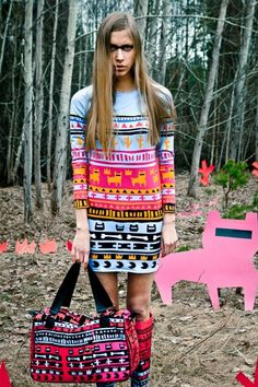 QooQoo, a Latvian fashion label characterised by bold patterns rich in neon colour, incorporates all manners of pop-inspired goodness into their garments. If criminal bears, tribal motifs, otherworldly galaxies and ethereal gardens are your thing - QooQoo has you covered.
