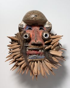 Tubular eyes and the fringe of carved leopard canine teeth identify this mask as male. Such masks appeared only during very important moments. The dancer wore a leopard skin over his head and Tribal Images, Tribal Art, Tribal African, African Art, Liberia, Art Premier, Cleveland Museum Of Art, Cool Masks, Masks Art