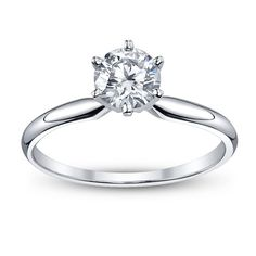 GIA Certified Round Brilliant Cut Solitaire Engagement Ring Metal: 18k White Gold Size: 6.5 Summary: Shape/cut: Round Cut Diamond Carat Weight: 0.35 ct Polish: Good Color: E Clarity: SI2 Symmetry: Ver