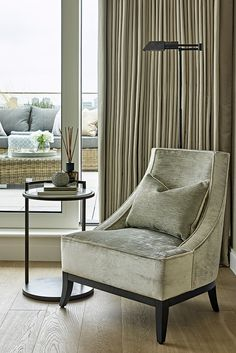 Comfortable chair, stylish side table and accent lighting Used Chairs, Dining Chairs, Study In London, Composite Adirondack Chairs, Neutral Color Scheme, Pent House, Modern Chairs, Accent Chairs, Couch