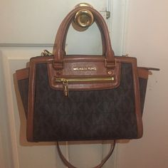 Michael Kors Brown MK logo bag. Gently used Authentic MK bag. Adjustable cross body strap (detachable). I really love this bag, but need to make some money. Sorry No trades, please do not ask. Price is somewhat negotiable make an offer if interested! Michael Kors Bags Crossbody Bags