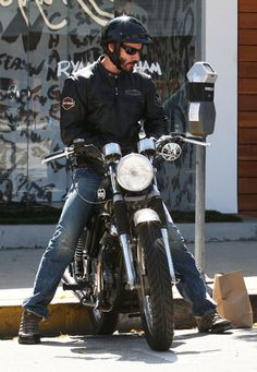 Actor Keanu Reeves sports his Harley Davidson jacket while running errands on his motorcycle in West Hollywood, CA on September 26th, 2012.